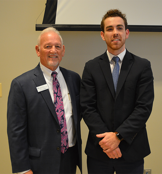 Bill Rhodes, professor at Augusta University, with Luke Eyrich, senior marketing student at the Hull College of Business.